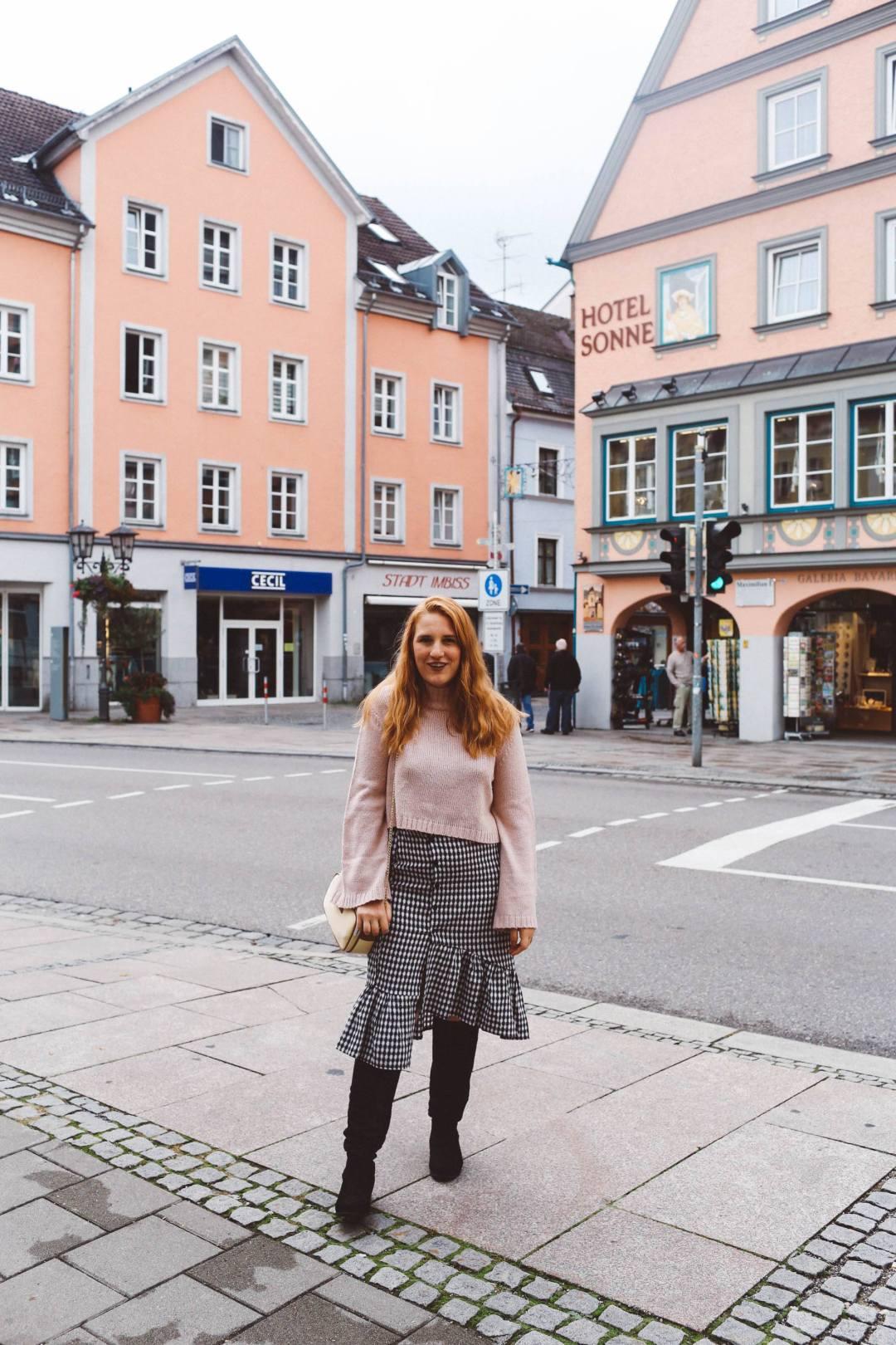 Füssen, Germany pink sweater gingham skirt boots