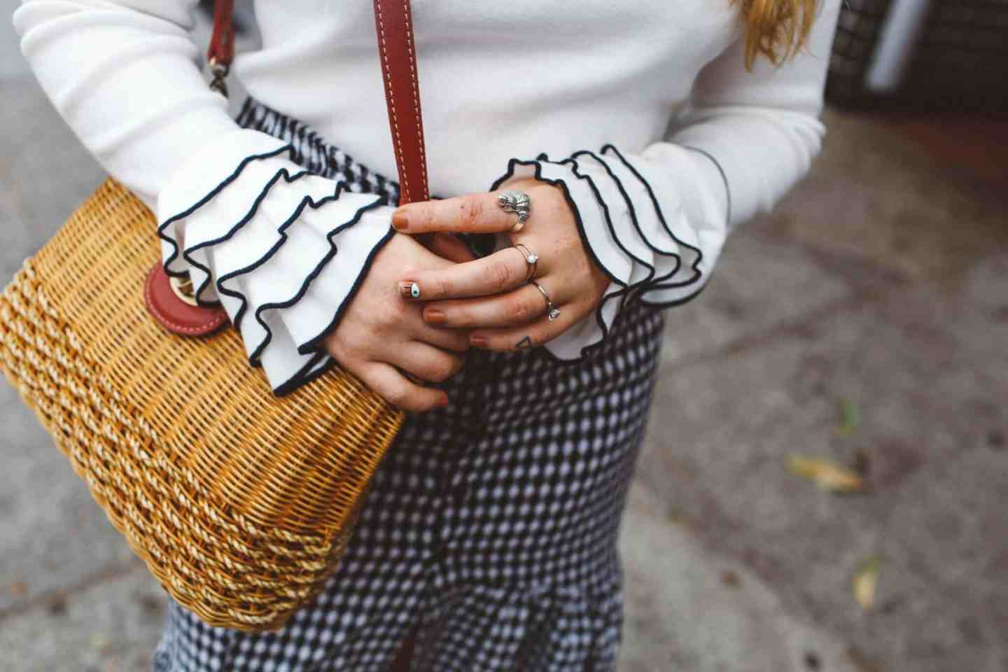 white sweater ruffles wicker purse