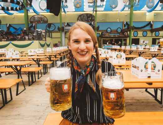 Oktoberfest Munich woman holding beer spaten