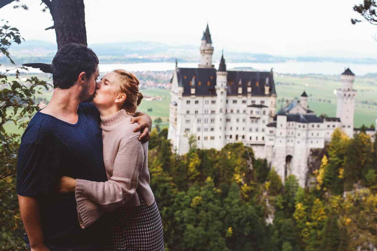 Neuschwanstein Castle couple kissing honeymoon