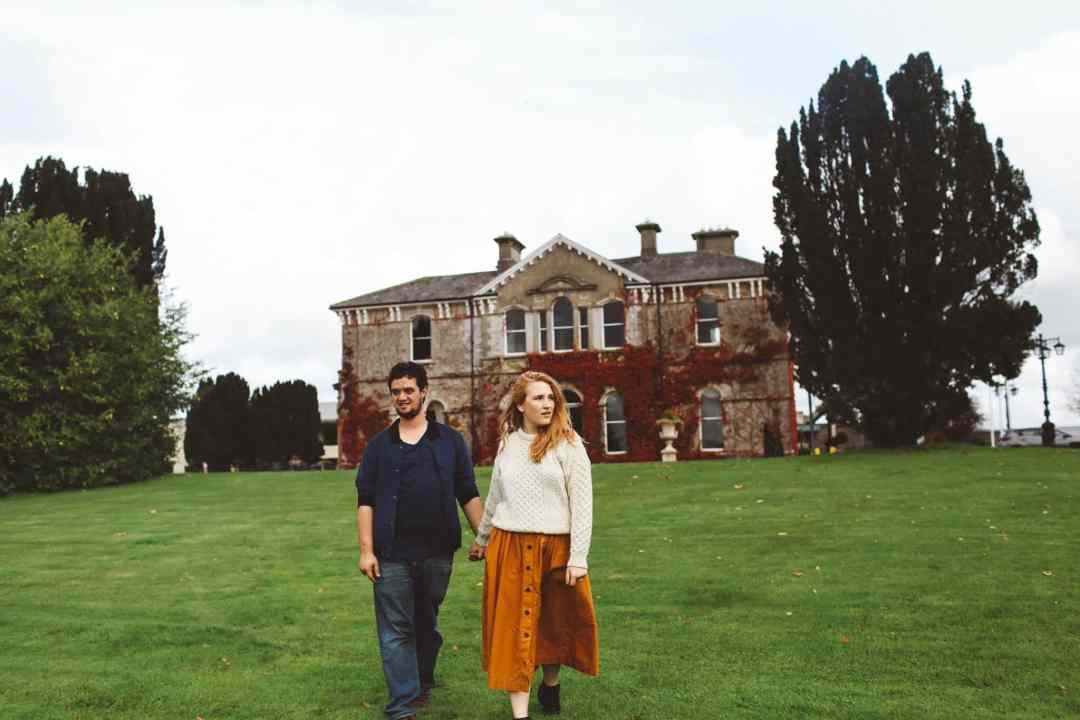 couple holding hands ireland orange skirt