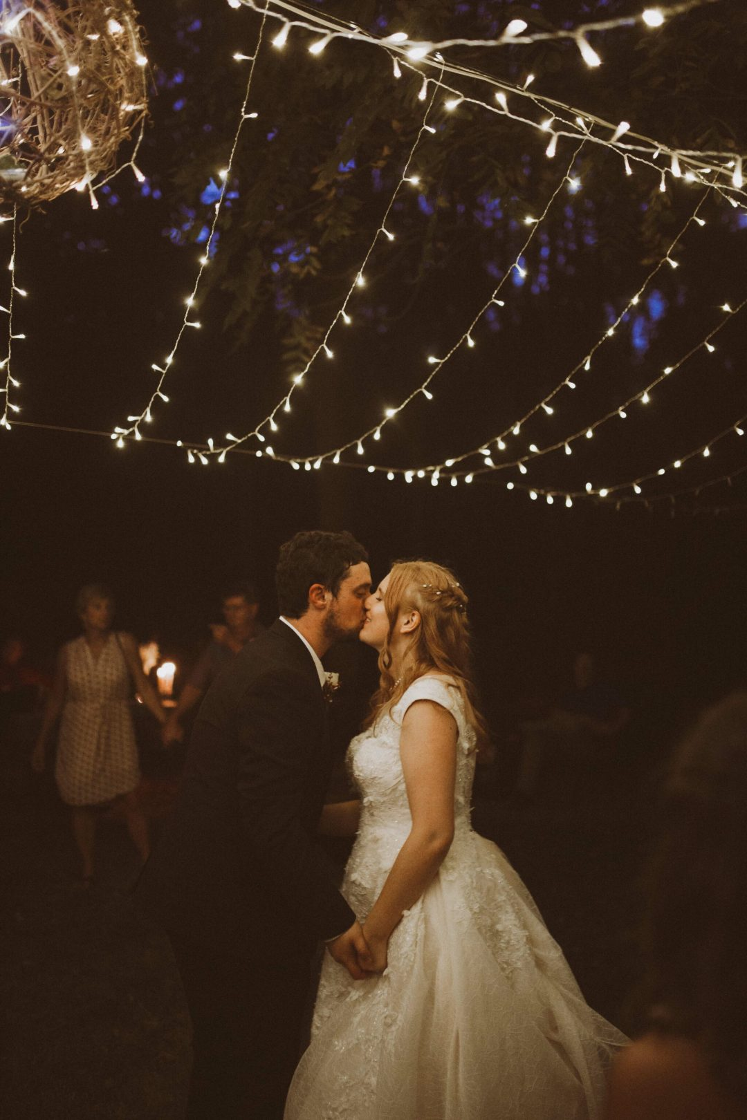 bride groom first dance outdoor string lights