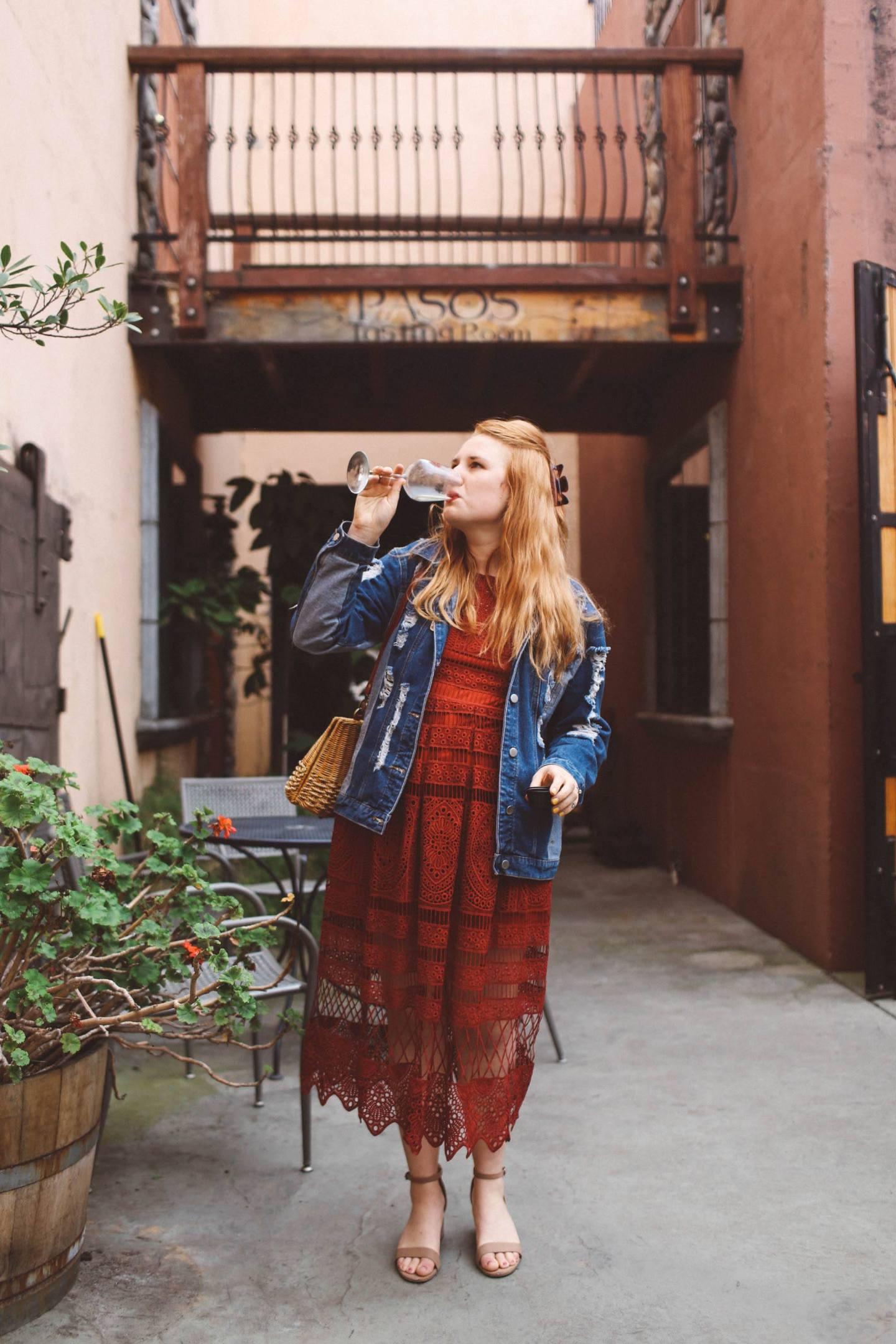 woman wine tasting red dress