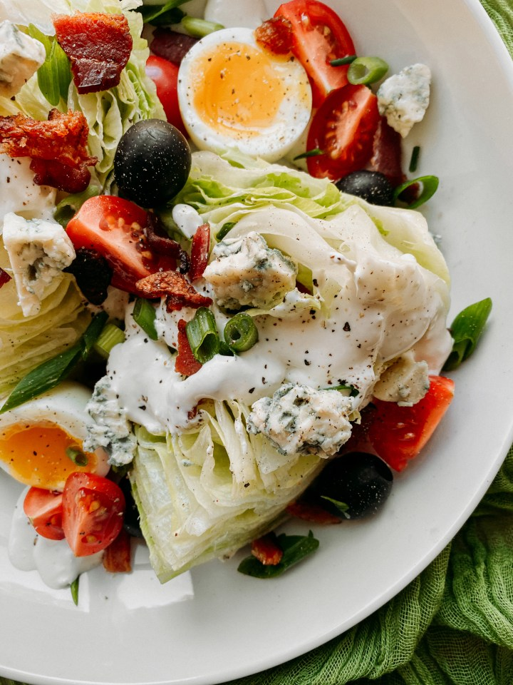 blue cheese and horseradish dressing on a wedge salad