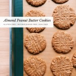 a silicone lined baking sheet with Almond Peanut Butter Cookies