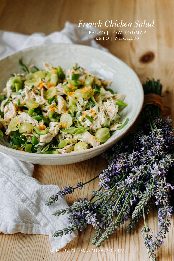 chicken sald in a white bowl with lavender resting nearby