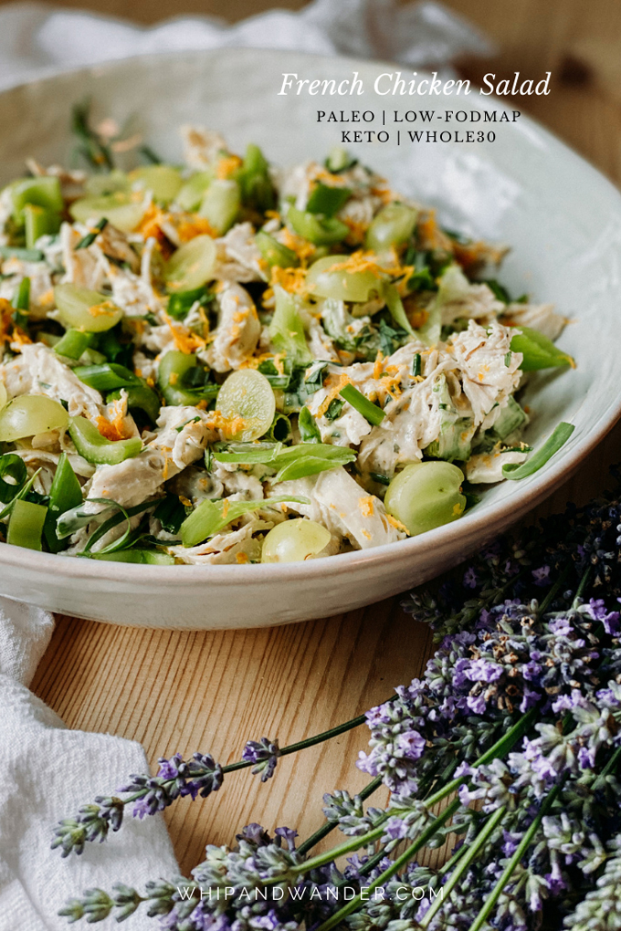 french chicken salad in a white serving dish with green grapes and lavender