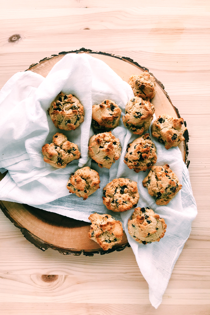 hagrids rock cakes with raisins, currants, on a white towel, on a wooden board