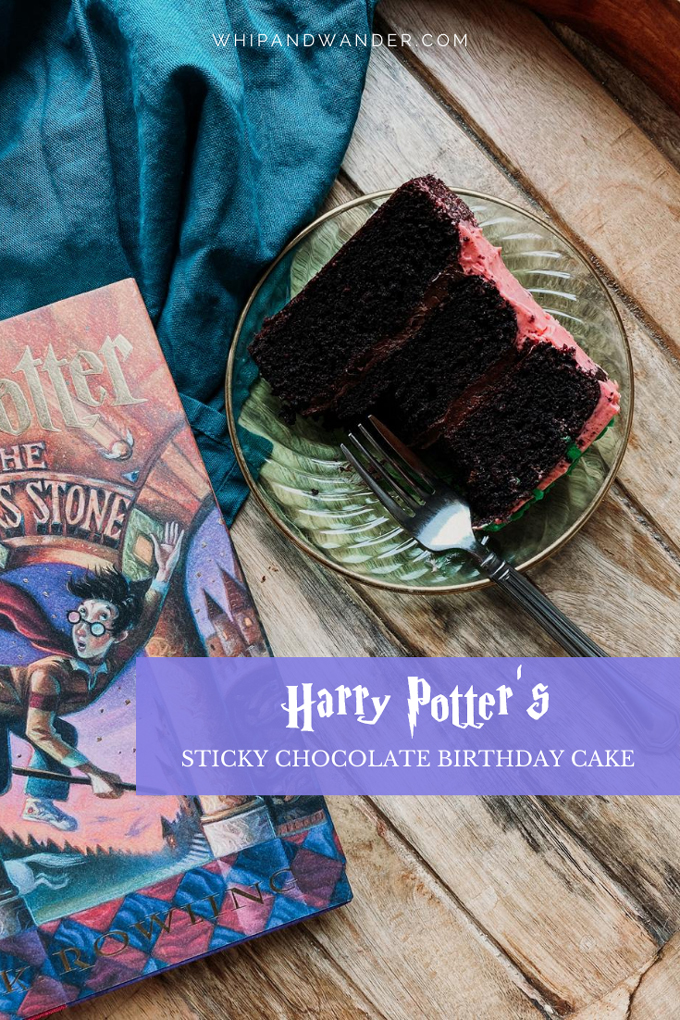 a harry potter book sitting next to a slice of harry potter's sticky chocolate birthday cake on a green glass plate