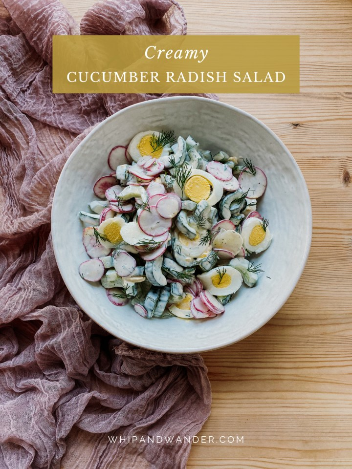 a large white serving bowl with a salad made of cucumbers, eggs, radish and creamy dressing