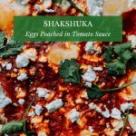closeup of shakshuka with feta and cilantro on top