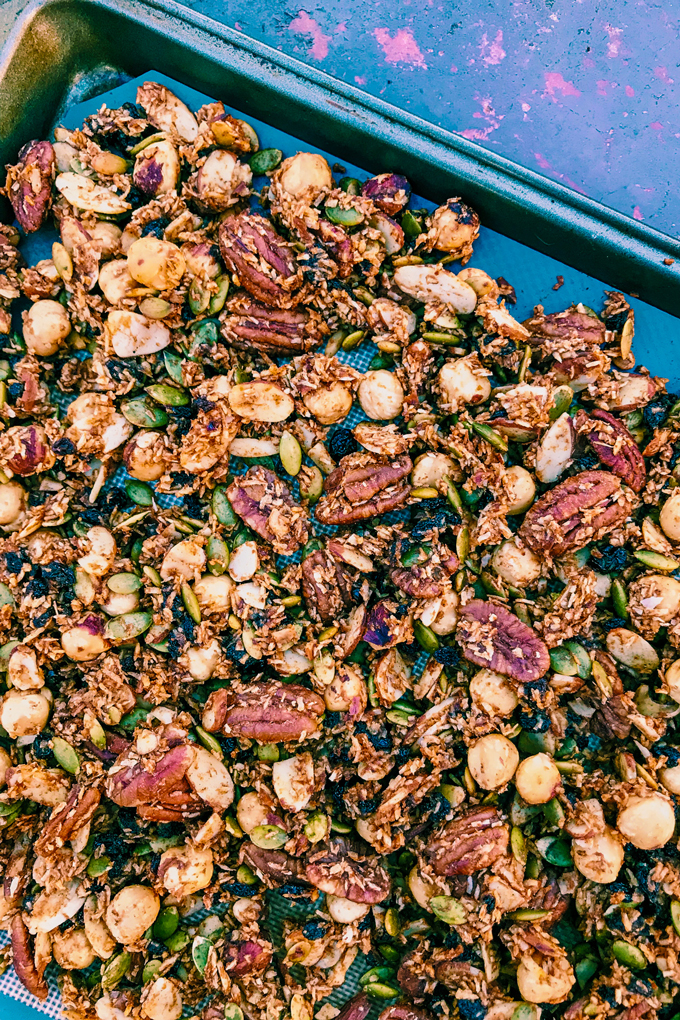 Pumpkin Spice Granola made of nuts on a baking sheet