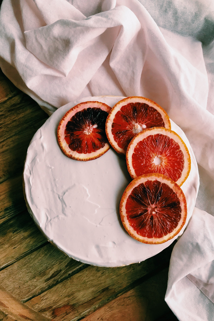 pale pink cheesecake with blood orange slices on top