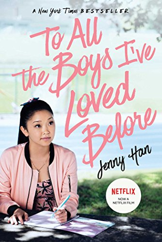 A girl in a pink jacket sitting at a table with pink text that says To All the Boys I've Loved Before