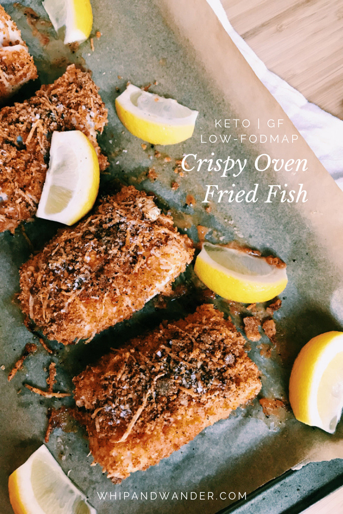 oven fried fish on a baking tray with lemon and white text overlay