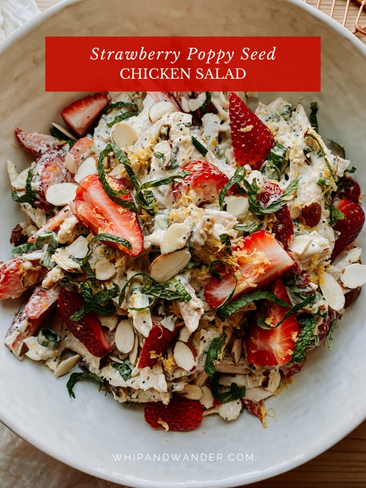 closeup of Strawberry Poppy Seed Chicken Salad in a white bowl topped with lemon zest and mint