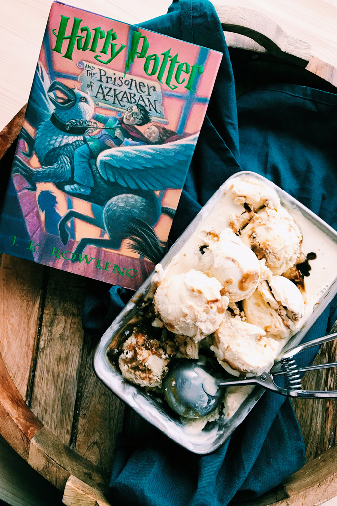 a pan full of butterbeer ice cream next to a harry potter book