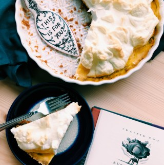 lemon meringue pie and a slice of pie and an open book