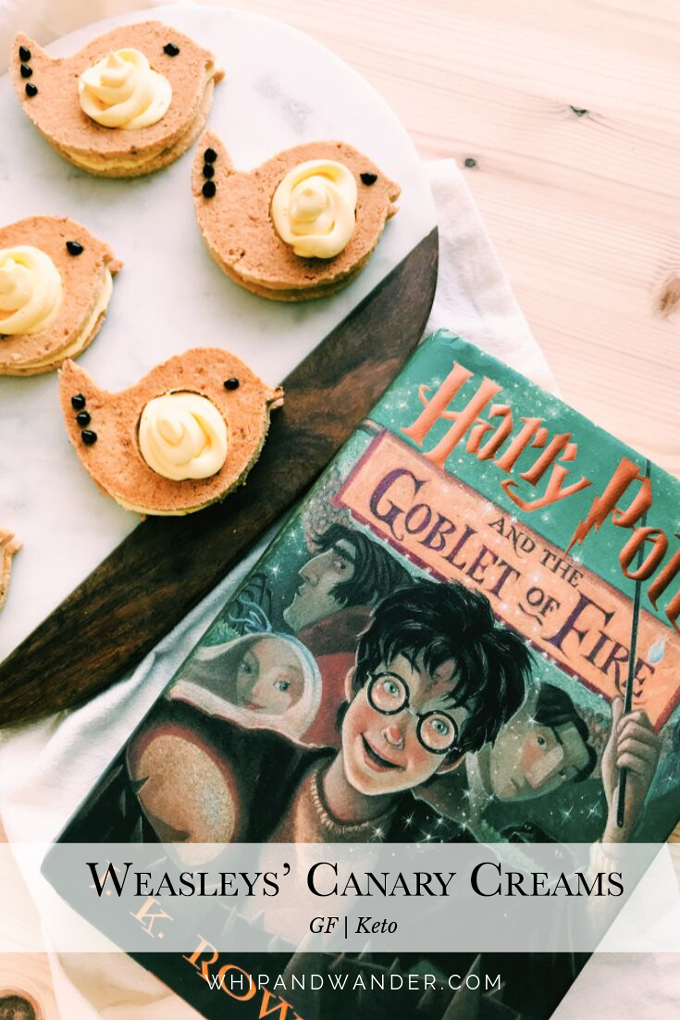 a harry potter book next to a tray of bird cookies