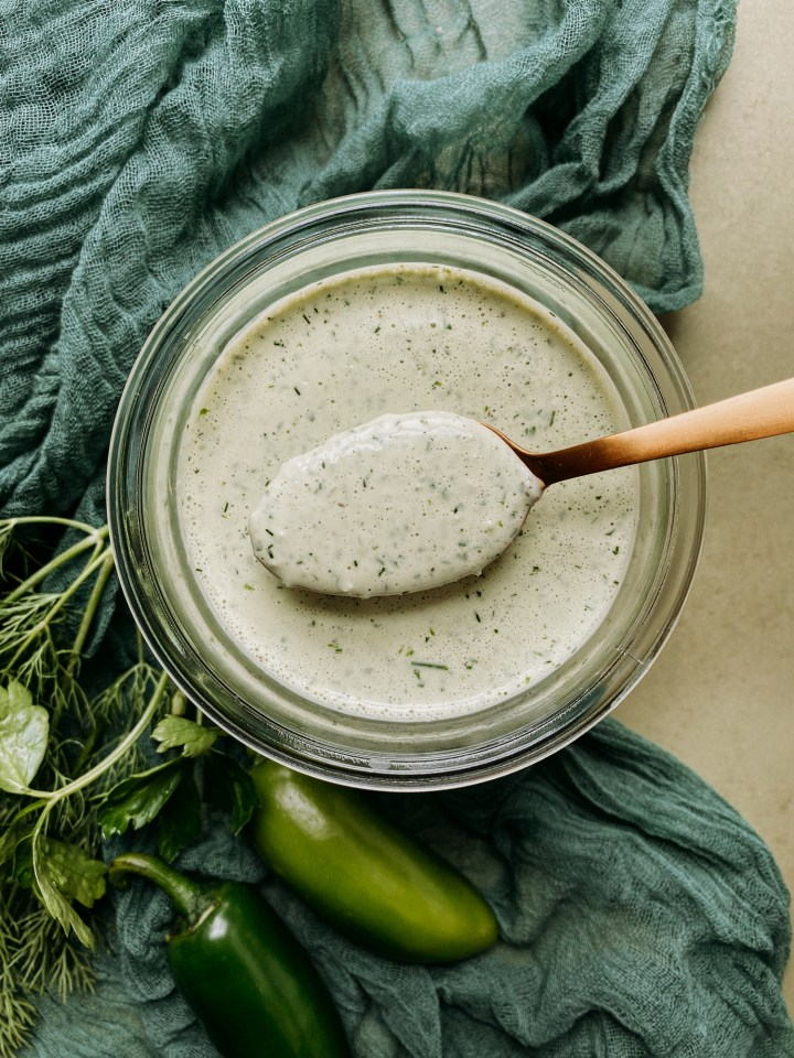 Buttermilk Jalapeno Ranch Dressing being spooned out by a gold spoon
