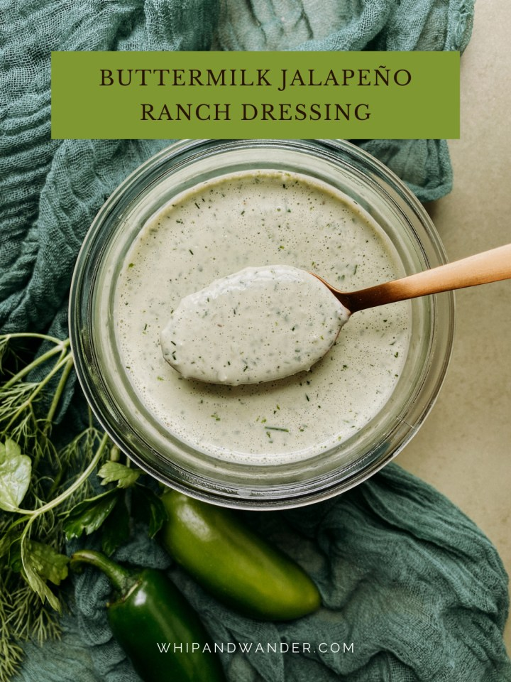 a gold spoon hovering over a glass jar of Buttermilk Jalapeno Ranch Dressing