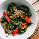 salted green and red peppers in a white dish