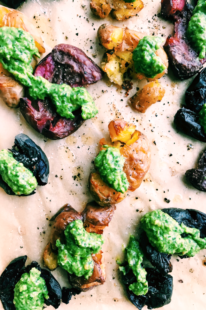 avocado chimichurri sauce dolloped on smashed potatoes