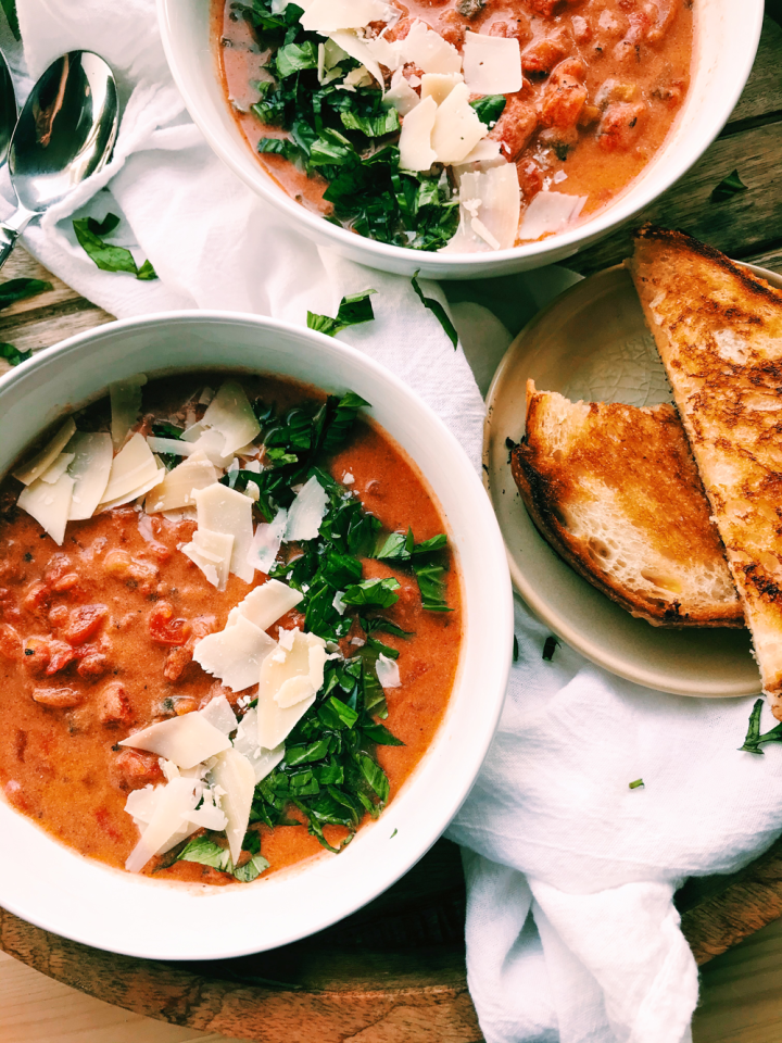 Chunky Tomato Basil Soup in white bowls with cheese sandwiches