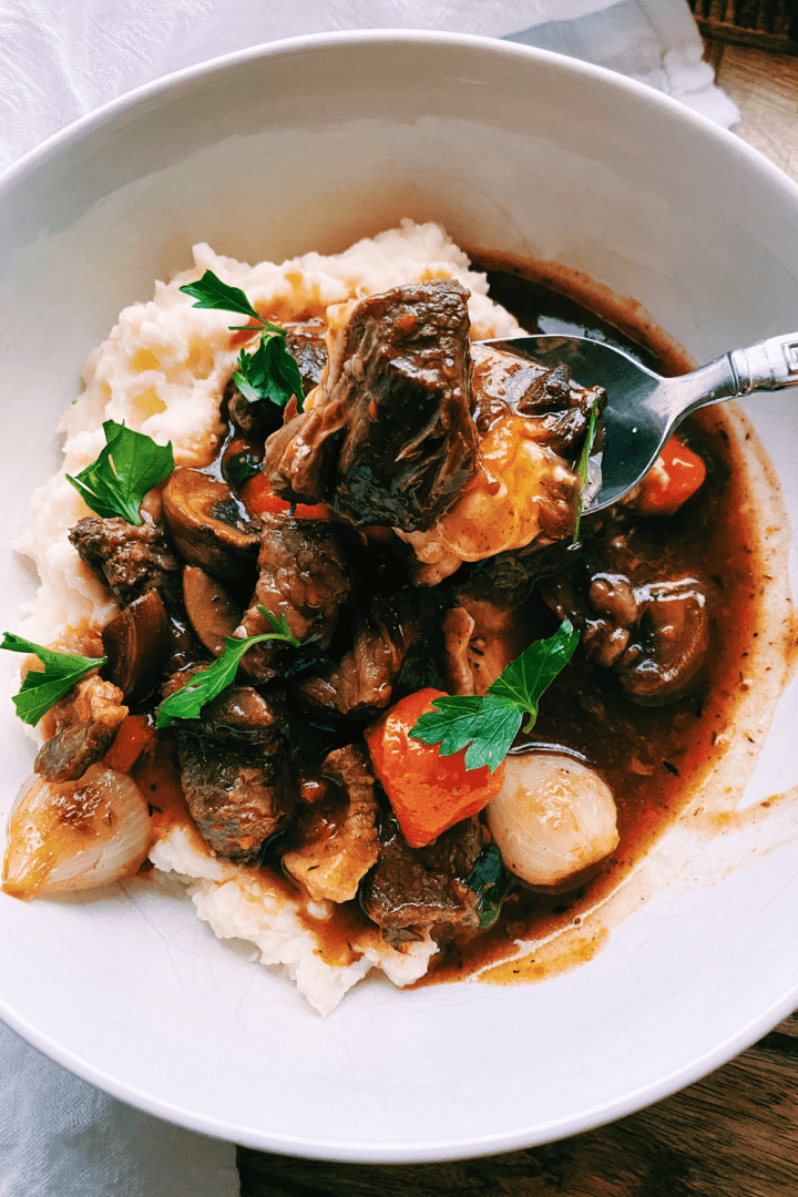 a spoonful of Pressure Cooker Beef Bourguignon and mashed potatoes