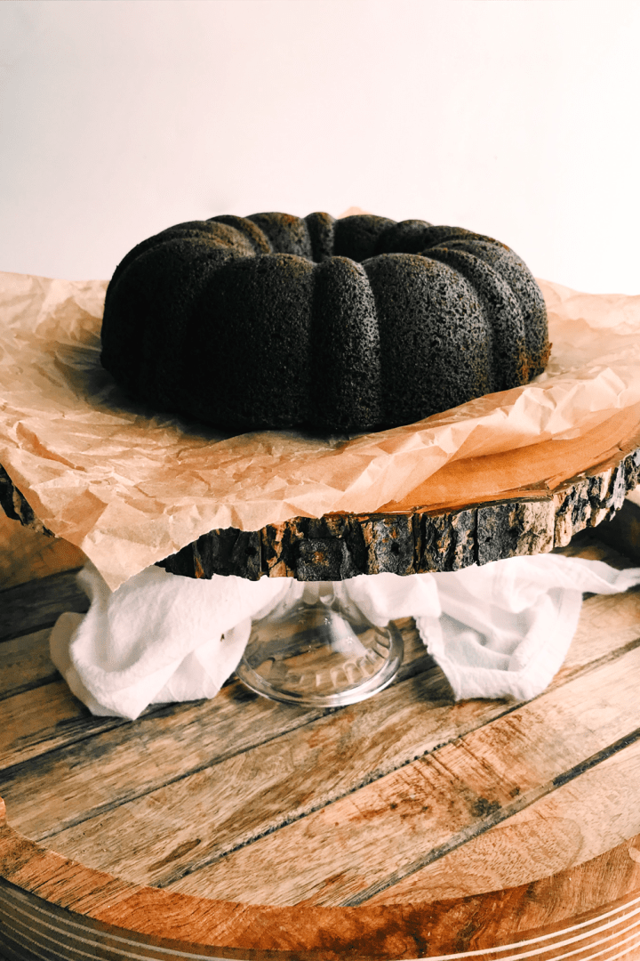 a cake stand with a pumpkin spice bundt cake on top