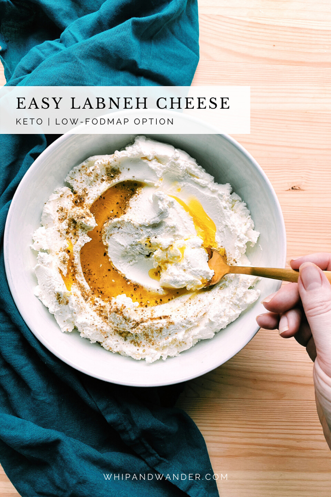 a bowl of labneh cheese with olive oil and spices and a hand spooning it up