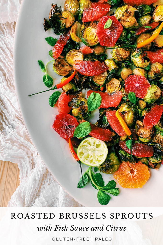 a platter of roasted brussels sprouts with winter citrus, peppers, fish sauce, mint, and limes