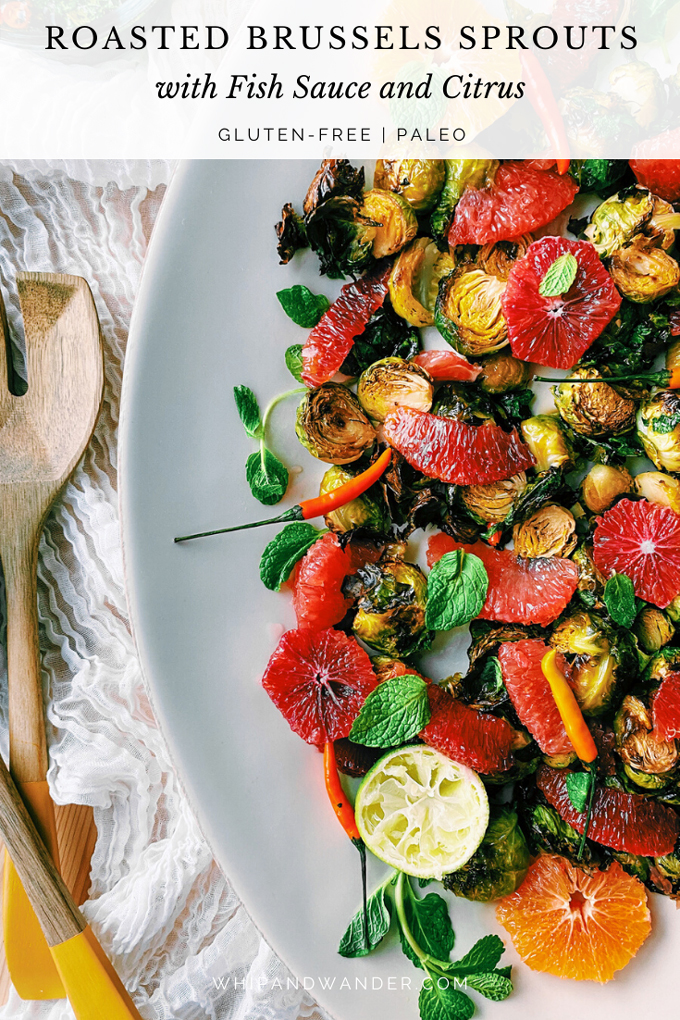 a white dish with lime, grapefruit, blood orange, cara cara orange, and mint topped roasted brussels sprouts