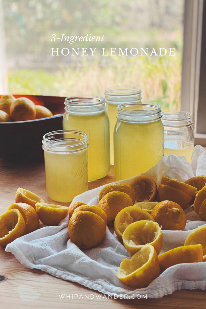 lemonade in jars and squeezed lemons in front of the jars