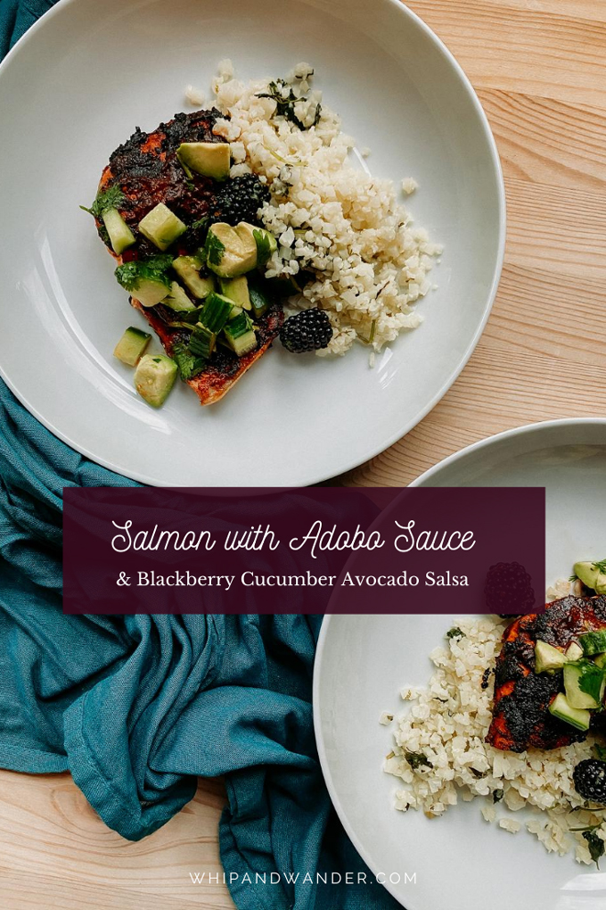 two white bowl filled with cauliflower rice and seared salmon with adobo sauce and a salsa made from blackberries, cucumbers, and avocado