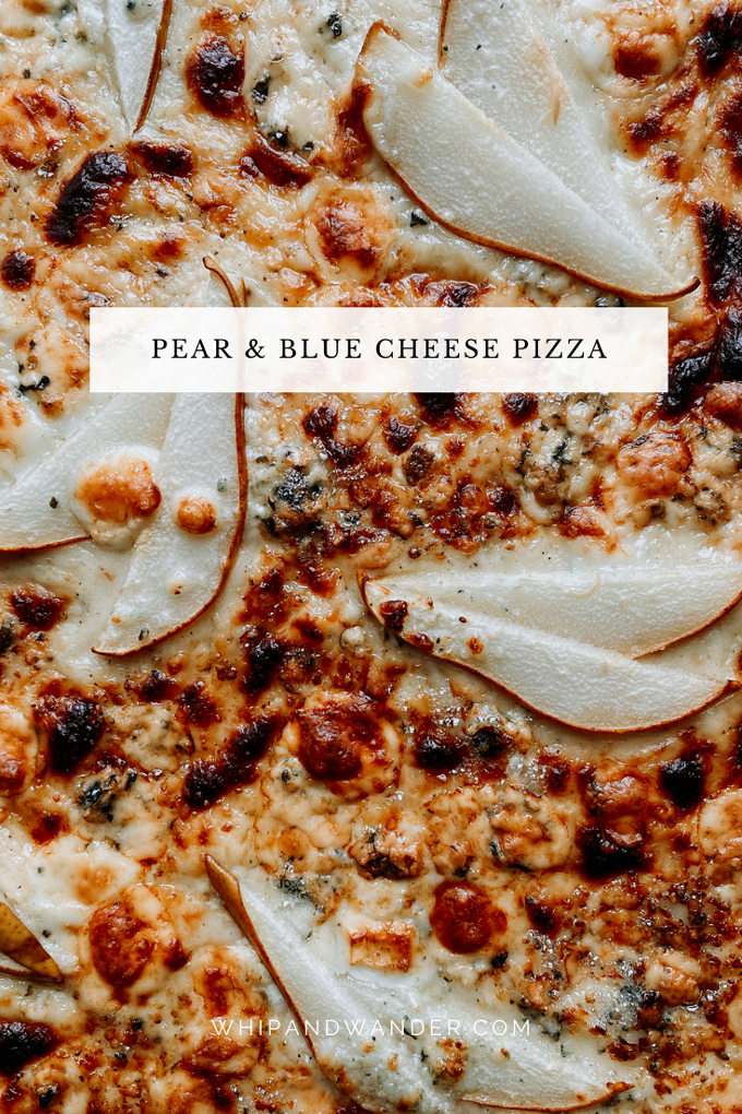 a white sauce pizza with blue cheese and pears
