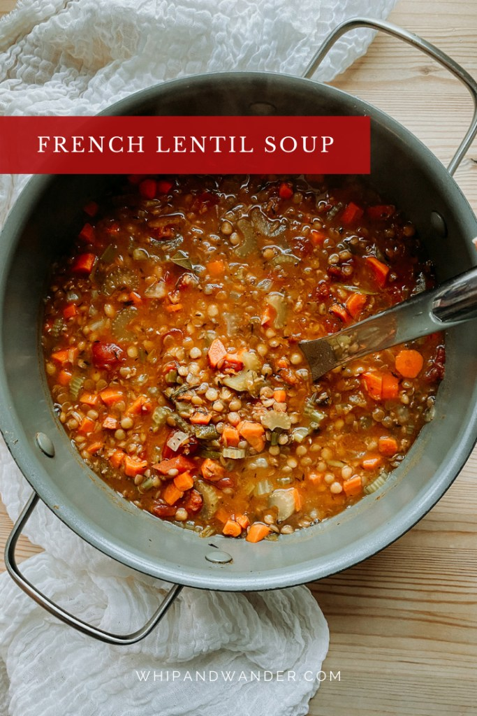 a pot of French Lentil Soup with a hand holding a ladle scooping into the pot