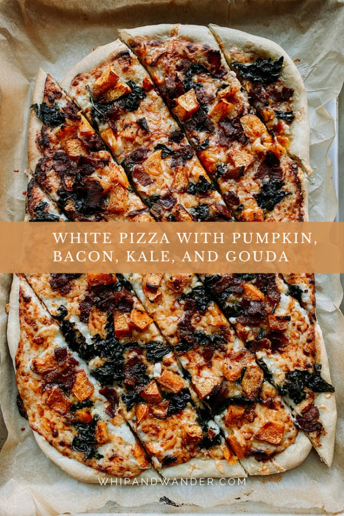 a pizza sliced into diagonal squares with kale, gouda, bacon, and pumpkin