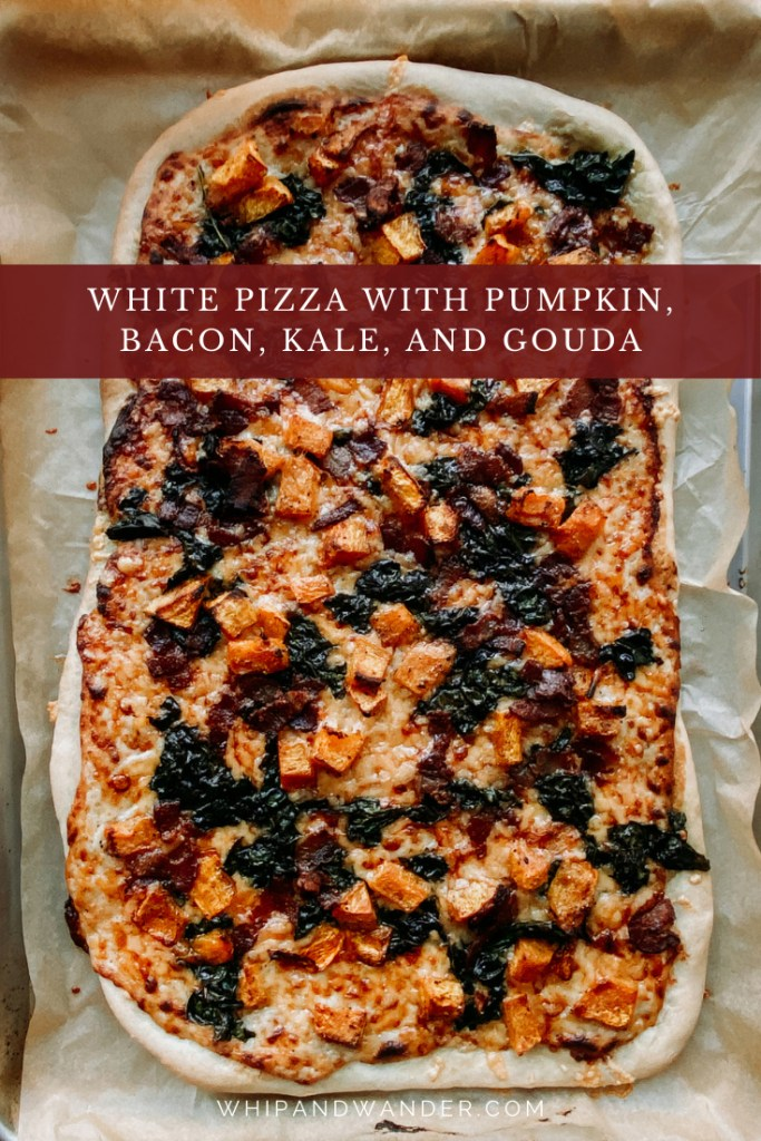 White Pizza with Pumpkin, Bacon, Kale, and Gouda on a baking sheet after it's been baked