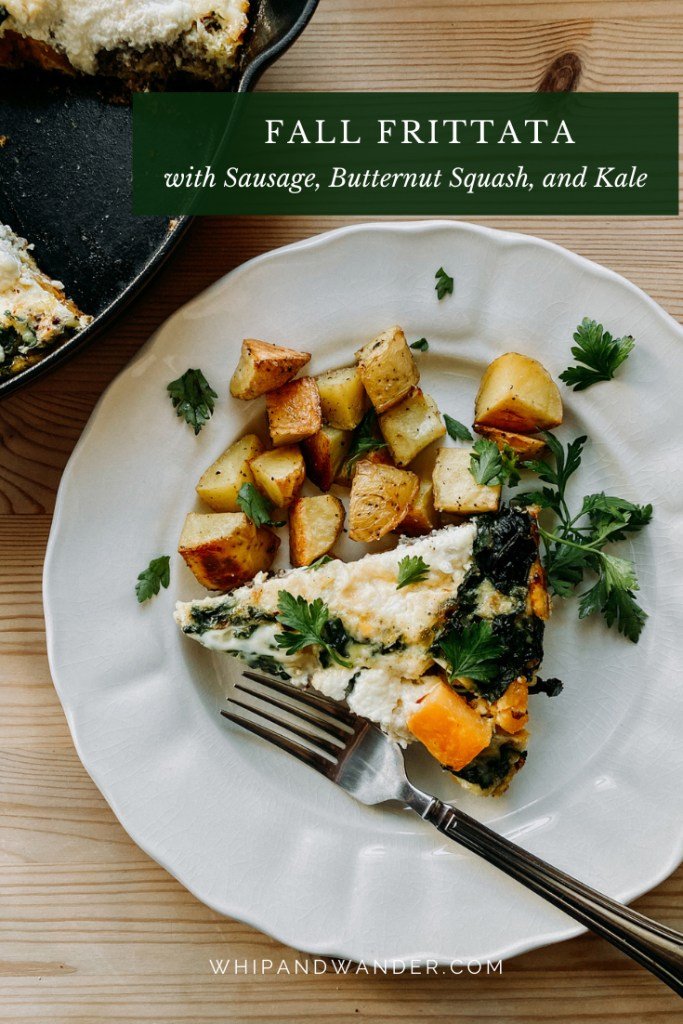 a slice of frittata with sausage, kale, squash, and ricotta on a white plate that also contains potatoes