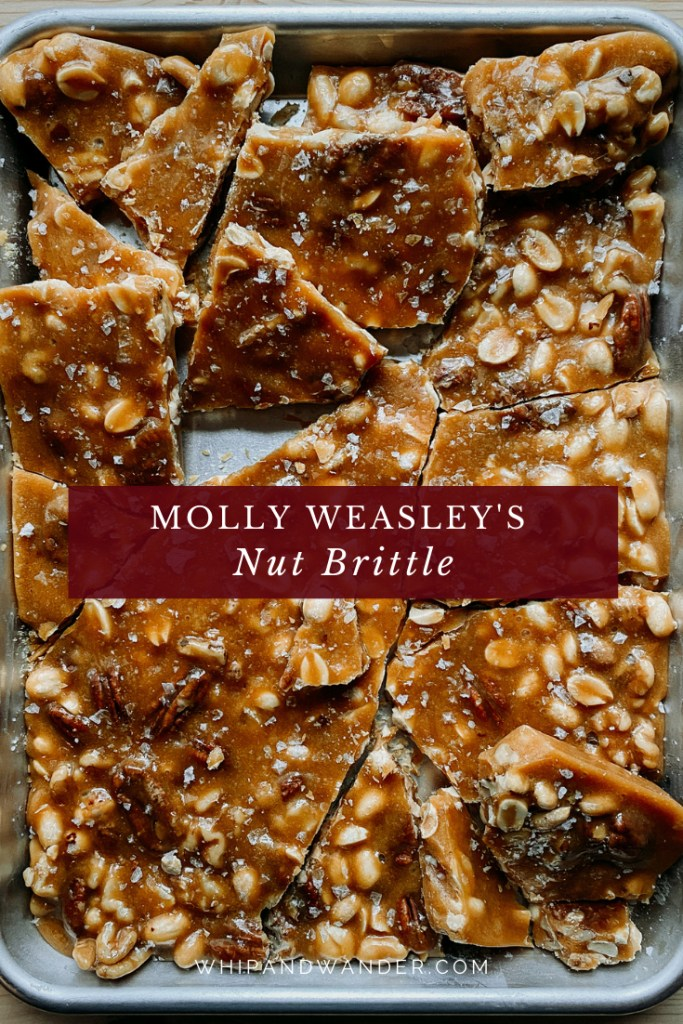 a tray full of broken pieces of nut brittle