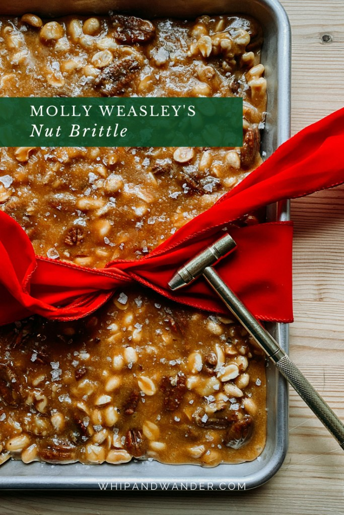 a small hammer resting on some bright red velvet ribbon that it partially tied around a tray of Molly Weasley's Nut Brittle