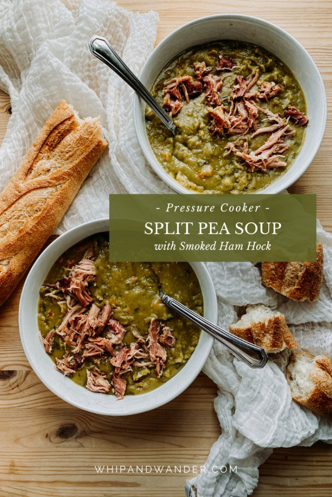 Instant Pot Split Pea Soup with Smoked Ham Hock in two white bowls with bread resting nearby on a wooden surface
