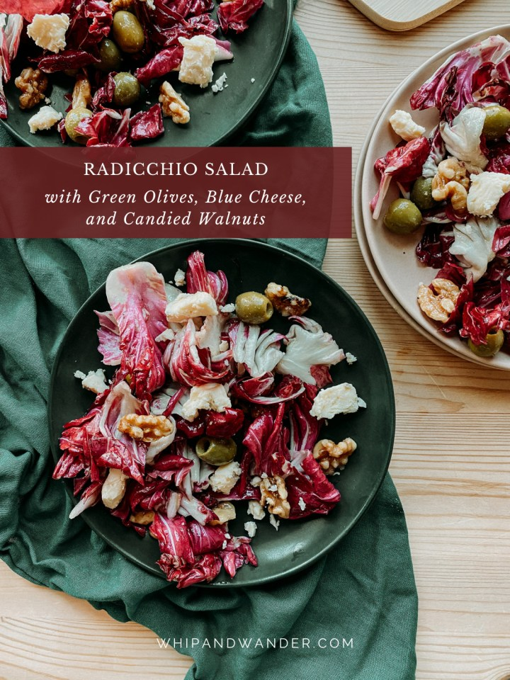 a dark green plate with dark red radicchio leaves, blue cheese, candies walnuts, and olives next to two more plates also containing salad and a dark green towel