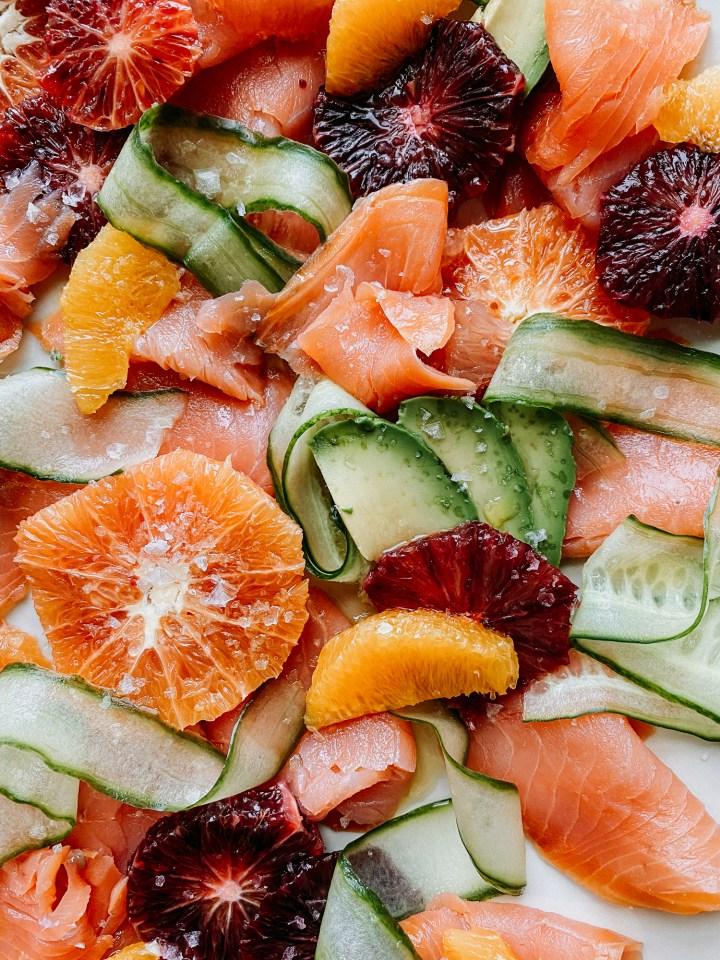 closeup of grapefruit, smoked salmon, cucumber, and avocado