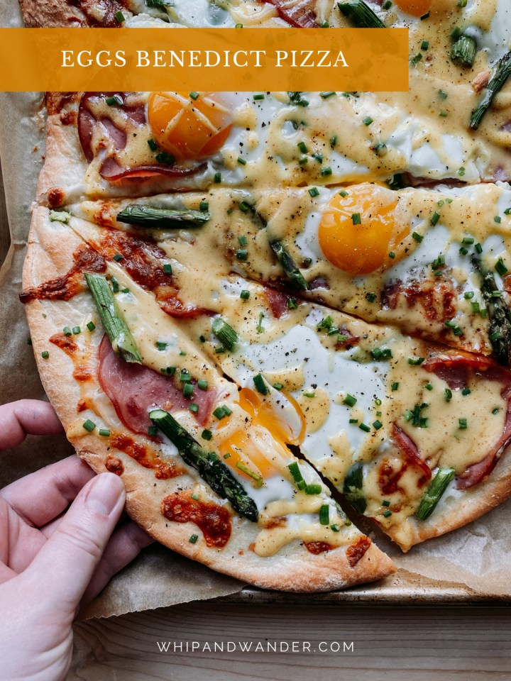 a piece of Eggs Benedict Pizza being pulled away from the whole by a hand