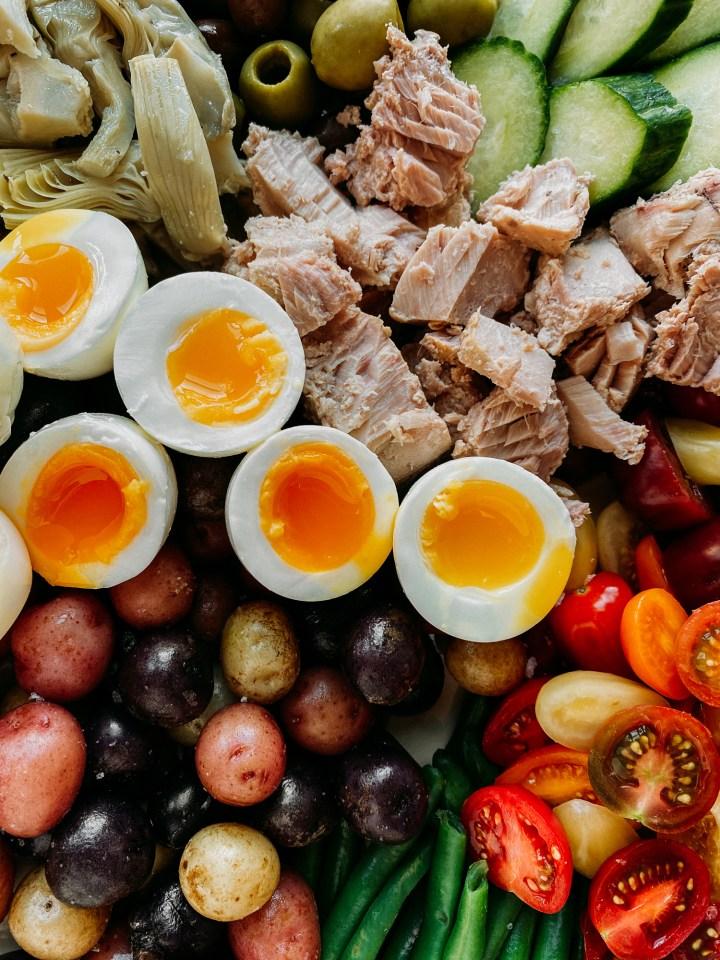 closeup of jammy eggs in a Tuna Salad Nicoise