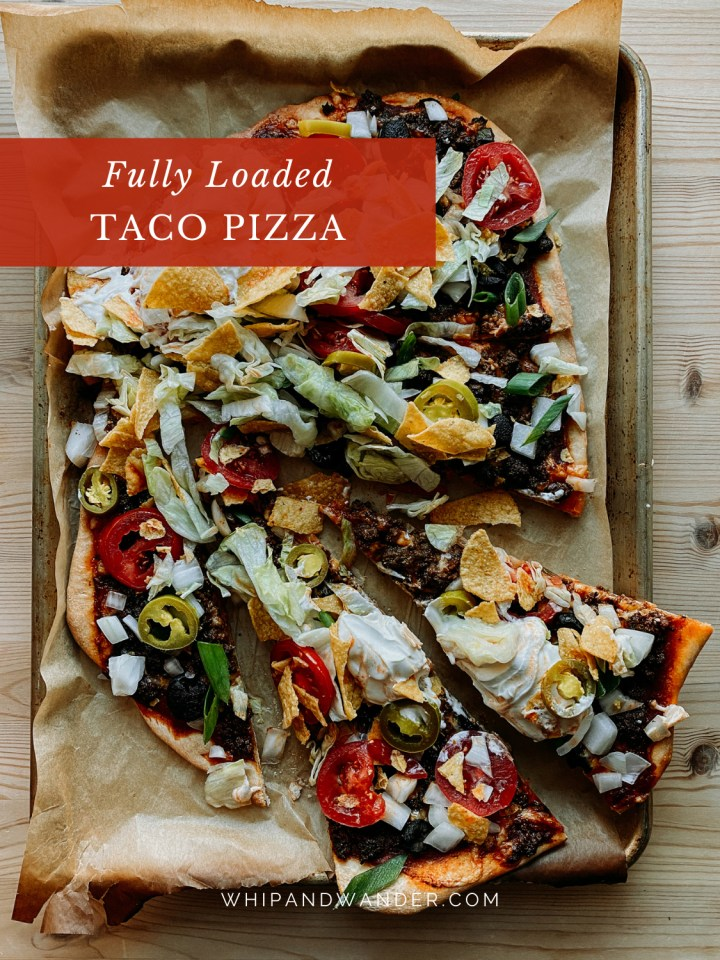 a baking sheet with slices of lettuce and tortlla chip topped Taco Pizza on top