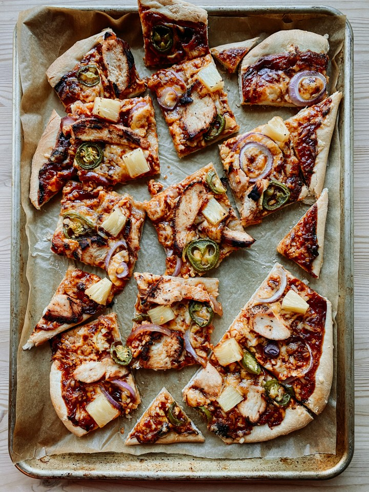 slices of BBQ Chicken Pizza on a baking sheet