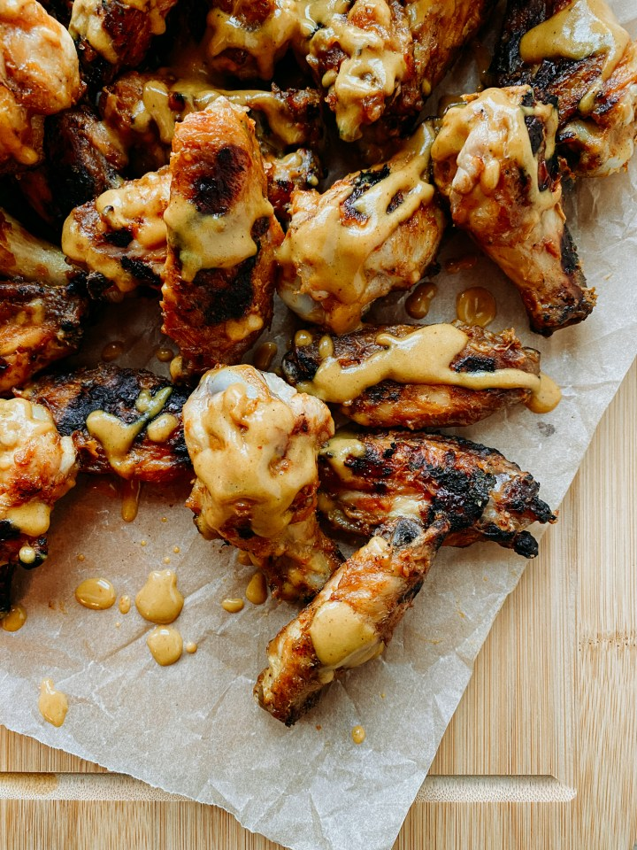 closeup of chicken wings with carolina gold sauce